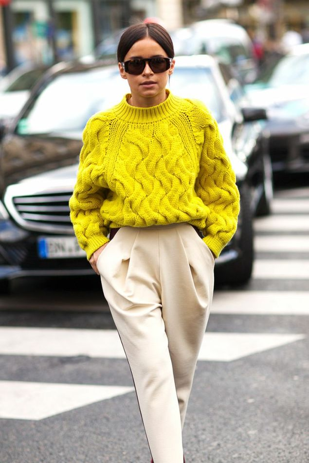 Miroslava-Duma-in-bright-yellow-oversized-cabled-sweater-and-pleaded-pants.-Very-chic-Paris-Fashion-Week-Street-style.